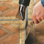 Heat the damaged tile
